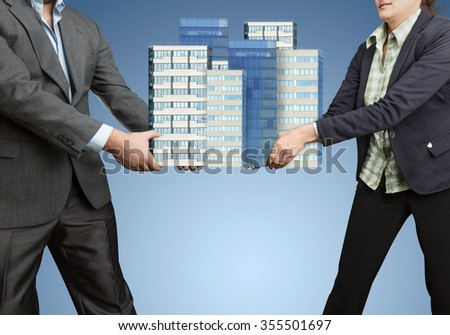 Businesspeople holding in their hands big office buildings - stock photo