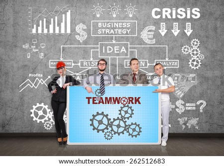 businesspeople holding plasma panel with teamwork concept - stock photo