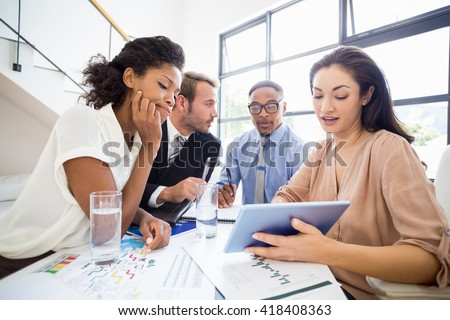 Businesspeople in a meeting in office - stock photo
