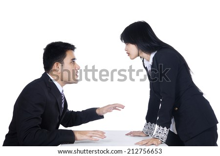 Businesspeople in an Business Fighting and Yelling at Each Other - stock photo