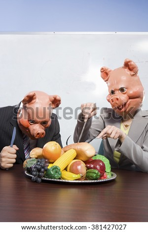 Businesspeople in pig masks with plastic food - stock photo