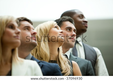 Businesspeople looking up in a stairs - stock photo