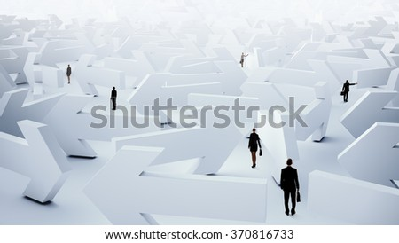 Businesspeople lost in maze - stock photo