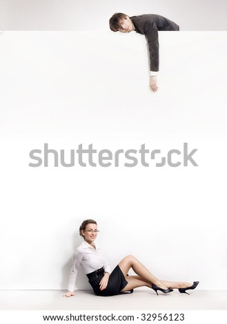 Businesspeople over an empty white board - stock photo
