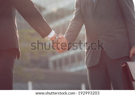 Businesspeople shaking hands - stock photo