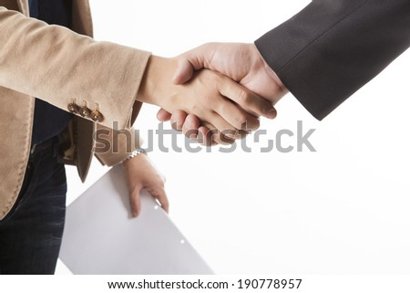 Businesspeople shaking hands isolated on white Background - stock photo