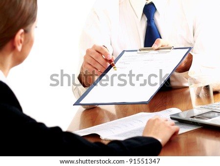 Businesspeople sitting at a table and signing a contract.isolated on white background - stock photo