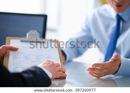 Businesspeople sitting at the desk on office - stock photo