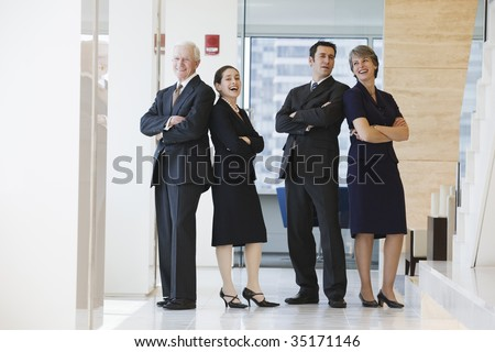 Businesspeople smiling. - stock photo