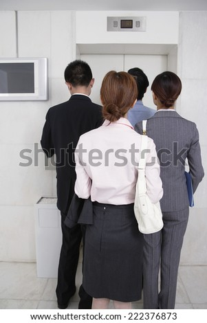 Businesspeople Waiting For Lift - stock photo