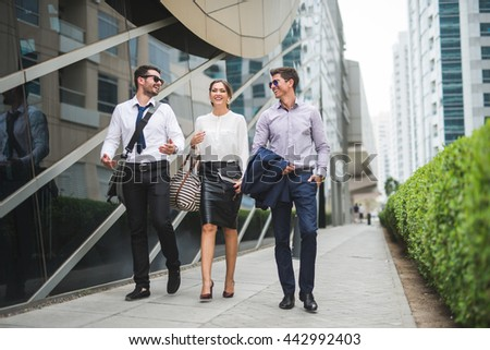 Businesspeople walking in the city - stock photo