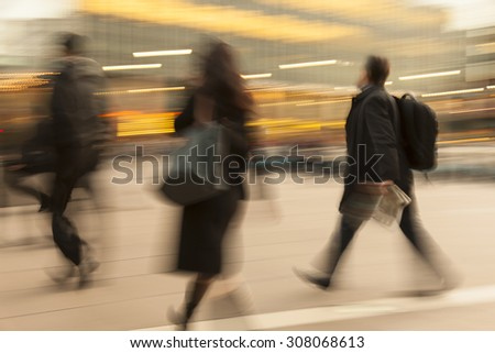 Businesspeople walking past a office building - stock photo