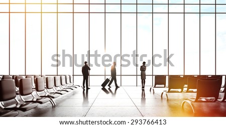 businesspeople with luggage in airport - stock photo