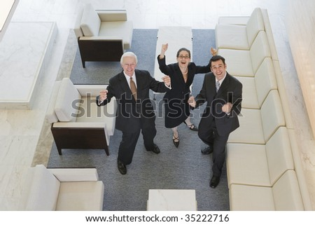 Businesspeople with raised arms - stock photo