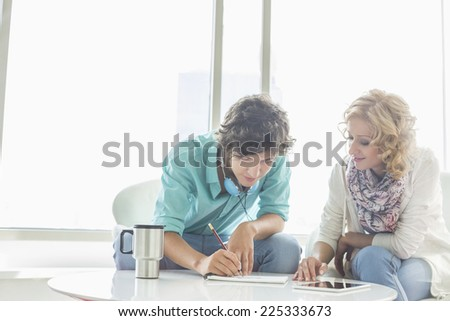 Businesspeople working at creative office lobby - stock photo