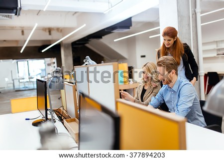 Businesspeople working in modern office and collaborating - stock photo
