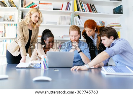 Businesspeople working in office and solving problems as a team - stock photo