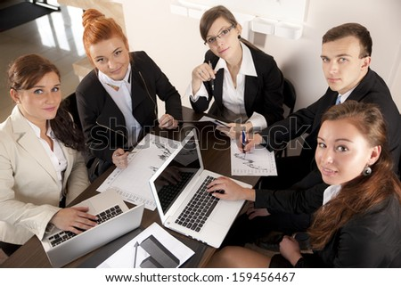 Businesspeople working on Laptop in the office - stock photo