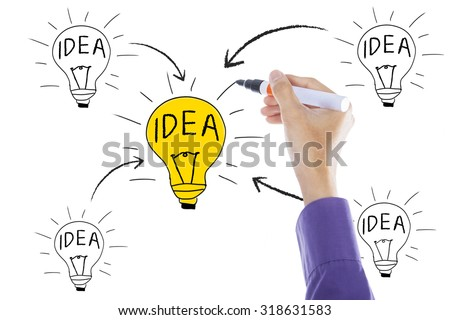 Businessperson hand drawing bulb with idea concept on the whiteboard - stock photo