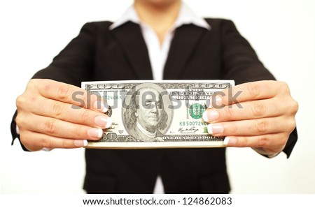Businessperson holding a hundred dollar bill - stock photo