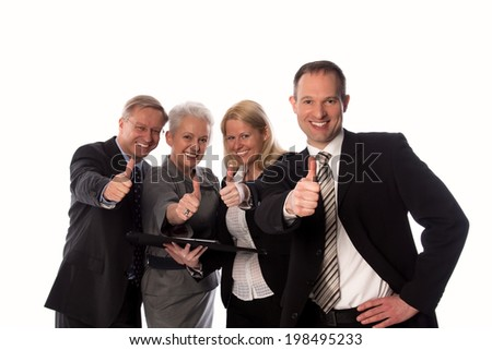 Businessteam showing thumb up - stock photo