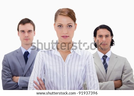 Businessteam with arms folded against a white background - stock photo