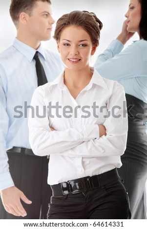 Businesswoman against two other businesspeople - stock photo