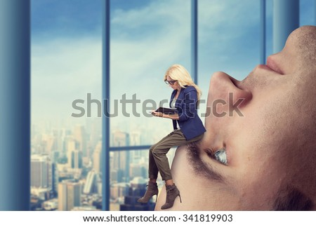 Businesswoman analyst sits on the male face - stock photo