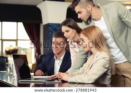 Businesswoman and business people working at notebook in conference room - stock photo