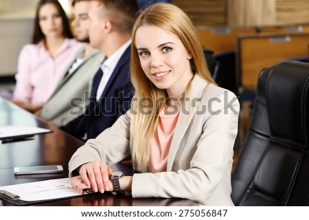 Businesswoman and business people working in conference room - stock photo
