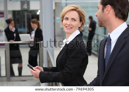Businesswoman at an airport - stock photo