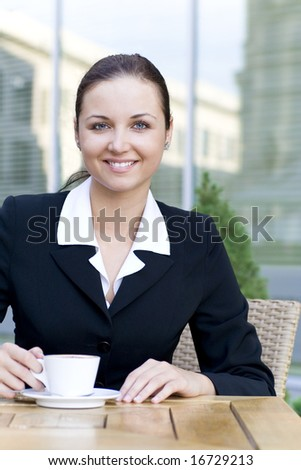 Businesswoman at outdoor cafe - stock photo