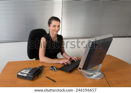Businesswoman at work - stock photo