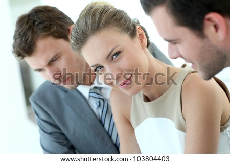Businesswoman attending meeting with colleagues - stock photo