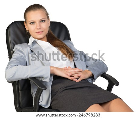 Businesswoman back in office chair, looking at camera cheerfully, with her hands clasped over her stomach. Isolated over white background - stock photo
