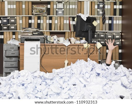 Businesswoman buried at the office - stock photo