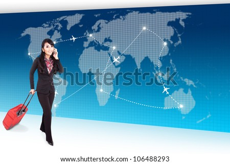 Businesswoman carrying suitcase and talking on the phone walks in front of global transportation map - stock photo