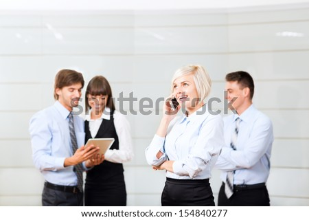 businesswoman cell phone call, at office conference hall, over businesspeople background, business woman happy smile, people at meeting comunicating working with tablet - stock photo