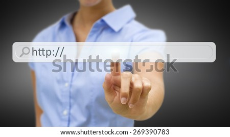 Businesswoman cliking on tactile interface web address bar���  - stock photo