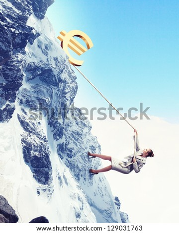 businesswoman climbing mountain with euro on top - stock photo