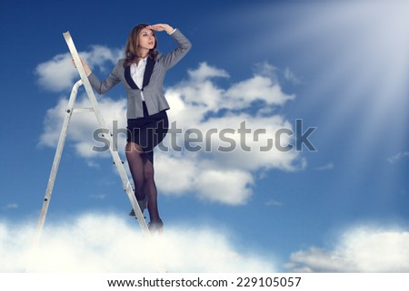 Businesswoman climbing the stairs to the sky looking into the distance. - stock photo