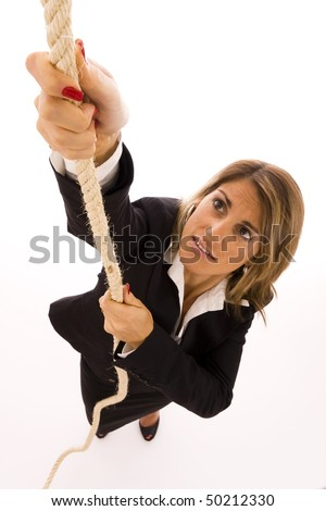 Businesswoman climbing up a rope - stock photo