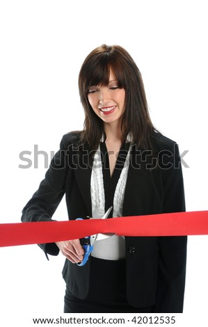 Businesswoman cutting red ribbon isolated over white background - stock photo