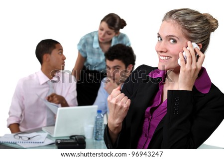 Businesswoman delighted with her phone call - stock photo