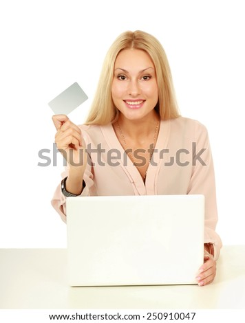 Businesswoman doing online shopping through laptop and credit card - stock photo