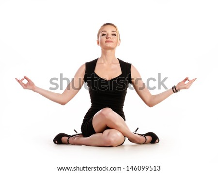Businesswoman doing yoga on white background - stock photo