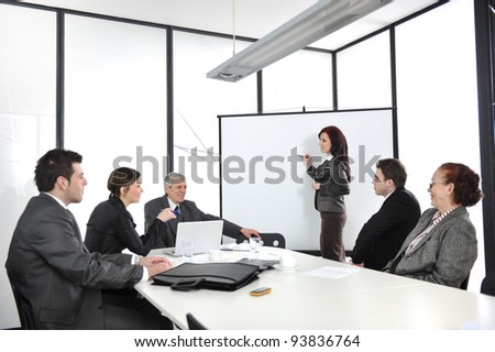 Businesswoman drawing a diagram during the presentation - stock photo