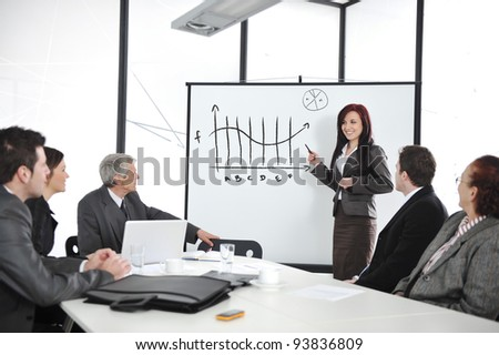 Businesswoman drawing a diagram during the presentation at office - stock photo