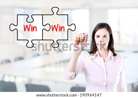 Businesswoman drawing a Win Win Puzzle Concept on the virtual screen. Office background. - stock photo