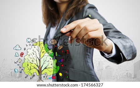 Businesswoman drawing business plan and sketches with marker - stock photo